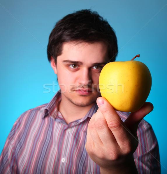 Young men keep yellow apple  Stock photo © Massonforstock