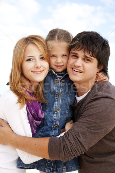 Young family at the beach in fall. Stock photo © Massonforstock
