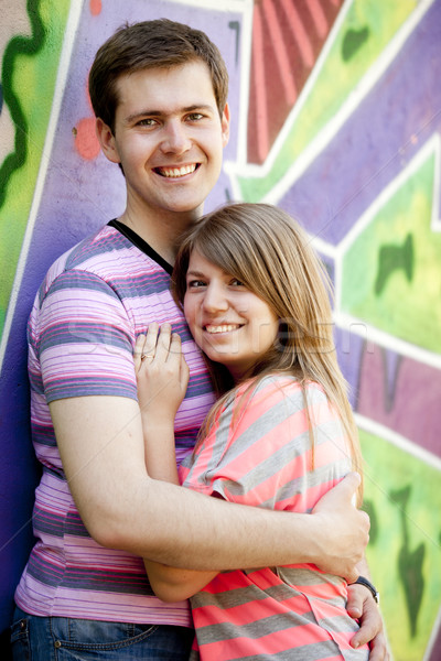 Young couple near graffiti background. Stock photo © Massonforstock