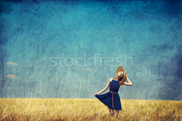 Lonely girl with suitcase at country. Photo in old color image s Stock photo © Massonforstock