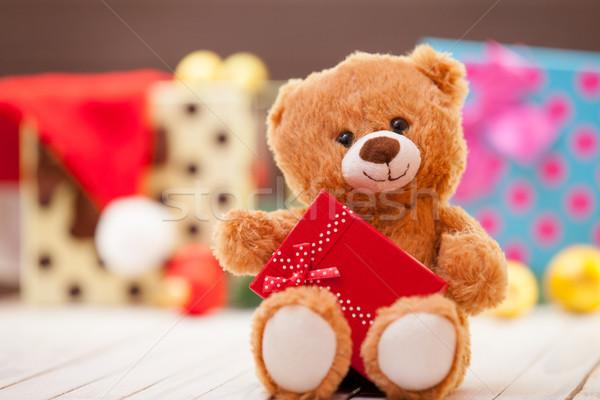 Pequeño osito de peluche regalo Navidad sonrisa rojo Foto stock © Massonforstock