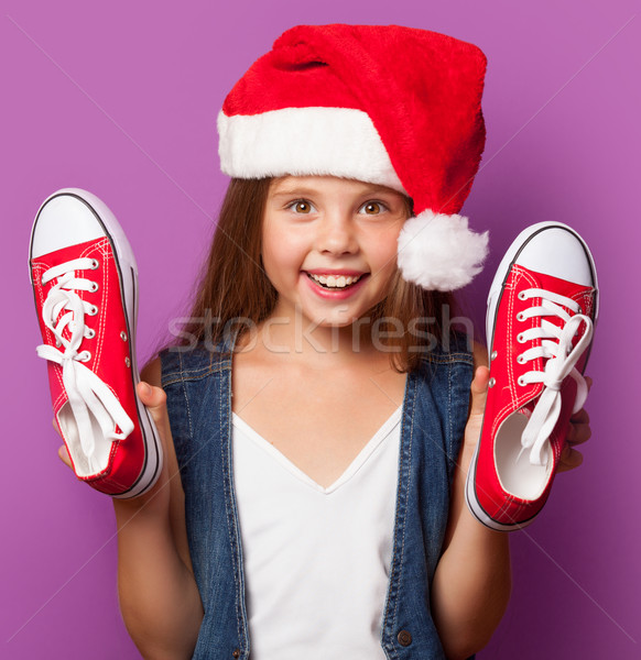 girl in red Santas hat with gumshoes Stock photo © Massonforstock