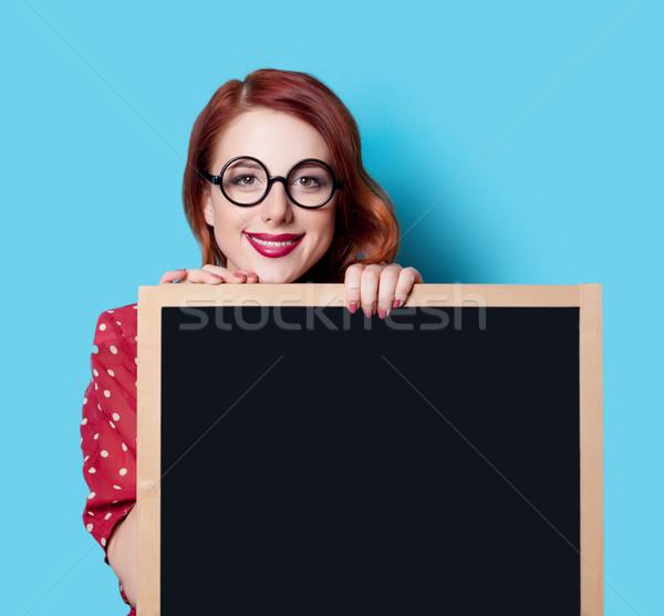 girl in red dress with blackboard Stock photo © Massonforstock