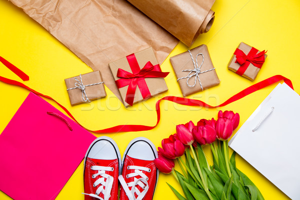 bunch of red tulips, red gumshoes, cool shopping bags, things fo Stock photo © Massonforstock