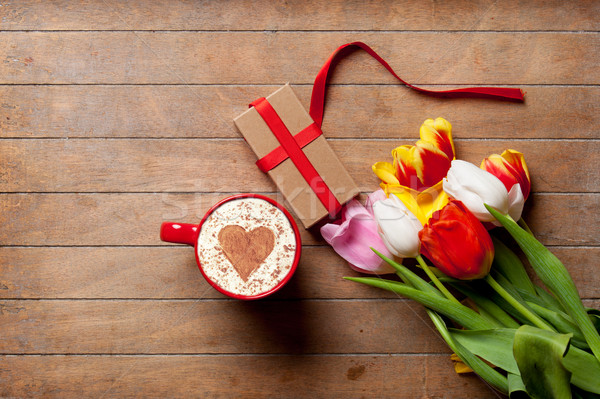 bunch of colorful tulips, gift and cup of coffee on the wonderfu Stock photo © Massonforstock