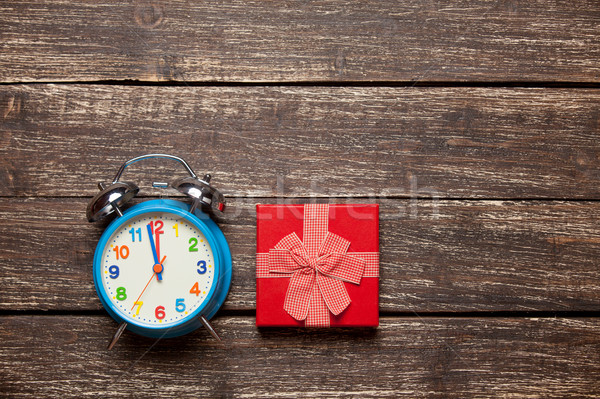 photo of cute wrapped gift and alarm clock on the wonderful brow Stock photo © Massonforstock