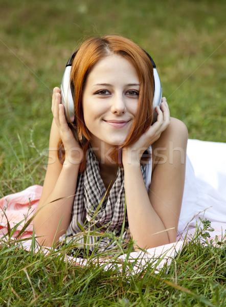 小さな ファッション 少女 ヘッドホン 緑の草 公園 ストックフォト © Massonforstock