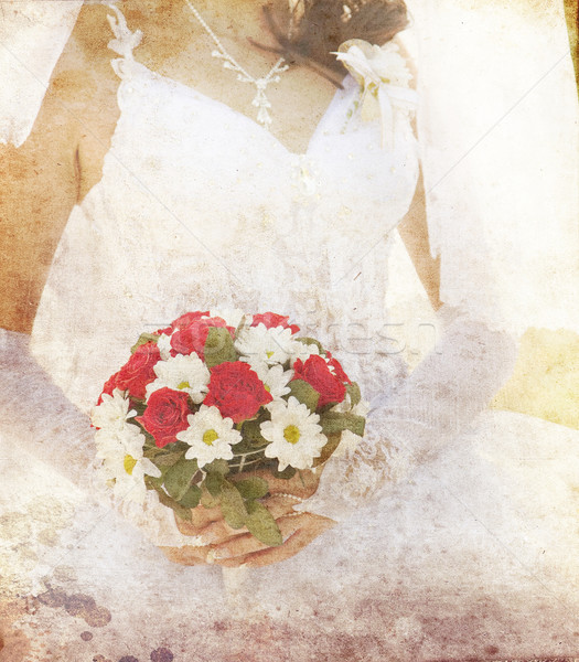 Stock photo: Bride holding beautiful red roses wedding flowers bouquet
