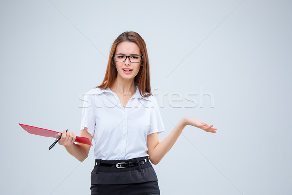 Сток-фото: молодые · деловой · женщины · пер · таблетка · отмечает · серый