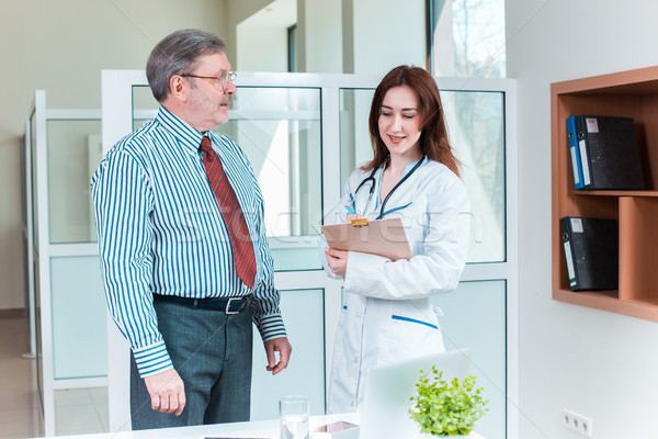 patient smiling to his doctor in medical office Stock photo © master1305