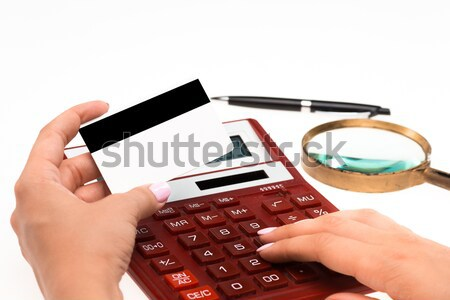 Concept for Internet shopping: hands with calculator and credit card Stock photo © master1305