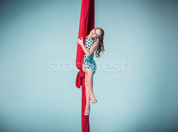 Graceful gymnast sitting with red fabrics Stock photo © master1305
