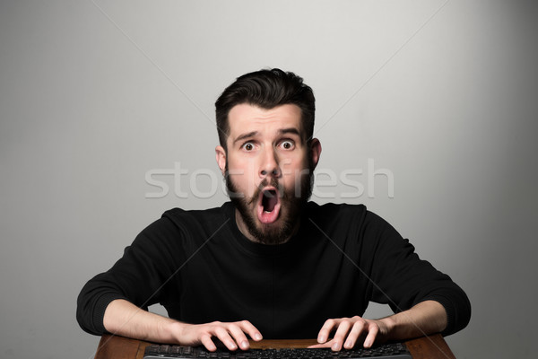 Crazy businessman sitting at table Stock photo © master1305