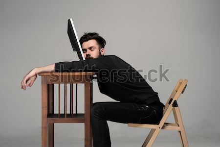 Jovem homem de negócios blogger adormecido laptop cinza Foto stock © master1305