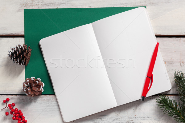Stock photo: The open notebook on the wooden table with a pen