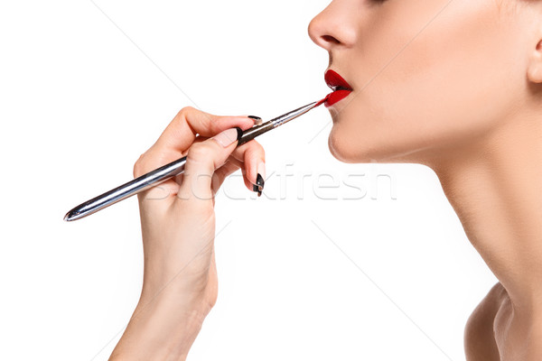 Beautiful female lips with make-up and brush Stock photo © master1305