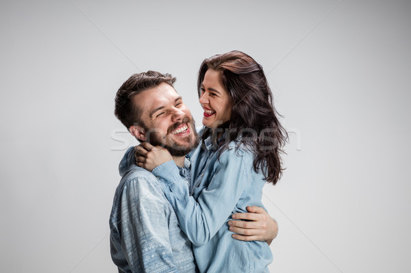 Portrait of happy couple on gray background Stock photo © master1305
