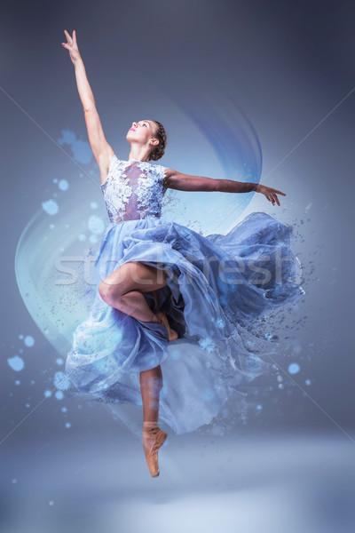 The beautiful ballerina dancing in blue long dress  Stock photo © master1305