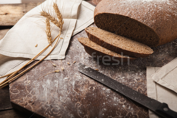 Bread rye spikelets on an wooden background Stock photo © master1305