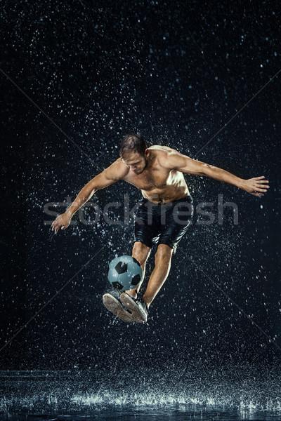 Gotas de água em torno de preto água homem Foto stock © master1305