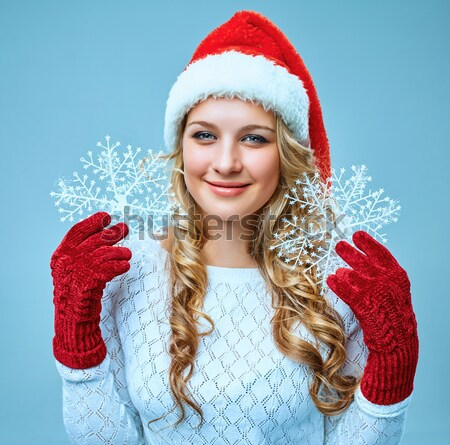 Beautiful young woman in Santa Claus clothes with snowflakes Stock photo © master1305