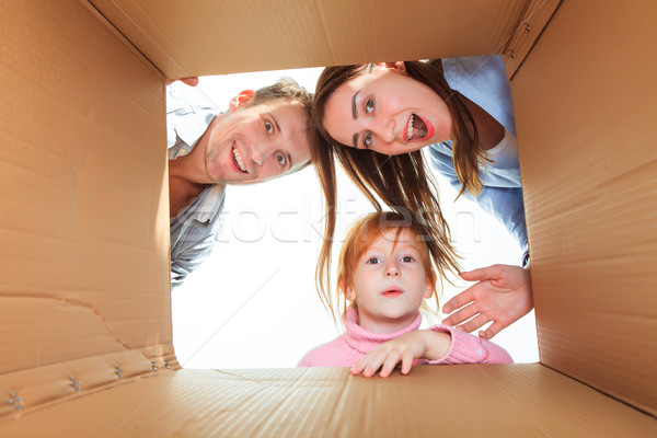 Family in a cardboard box ready for moving house Stock photo © master1305