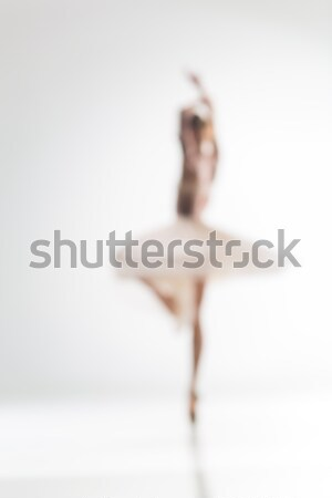 Stock photo: Blurred silhouette of ballerina on white background