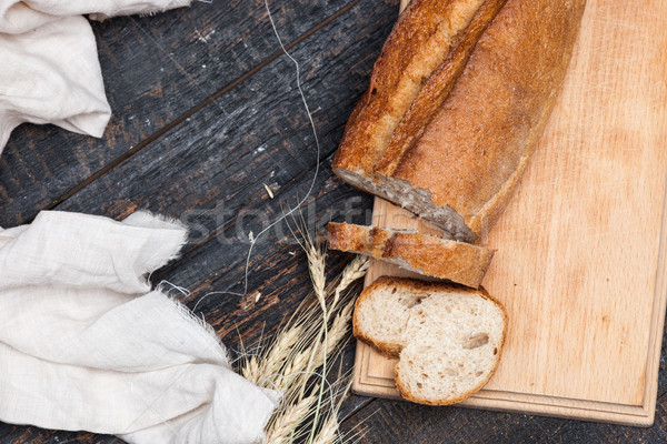 Rustic bread on wood table. Dark woody background with free text space. Stock photo © master1305