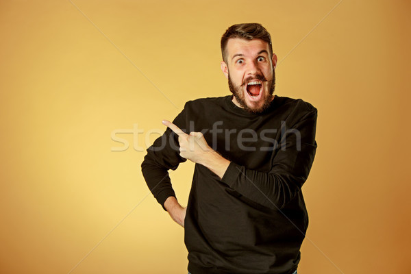 Portrait of young man with shocked facial expression Stock photo © master1305
