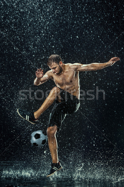 Water drops around football player under water Stock photo © master1305