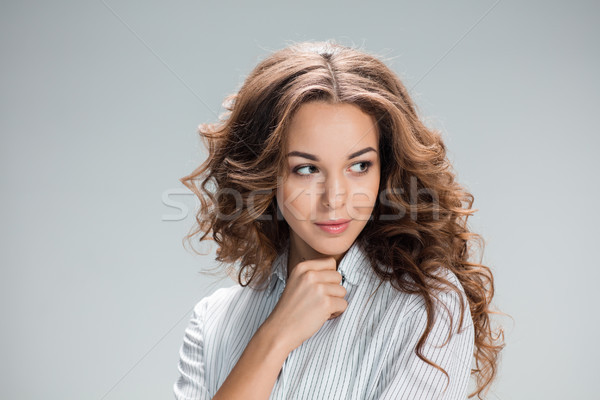 The happy thoughtful woman on gray background Stock photo © master1305