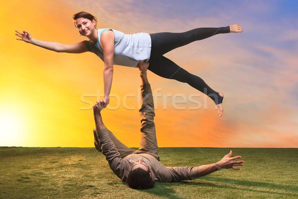 Két személy jóga naplemente égbolt nők boldog Stock fotó © master1305