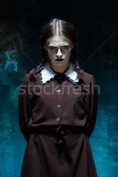 Portré fiatal lány iskolai egyenruha gyilkos nő portré nő Stock fotó © master1305