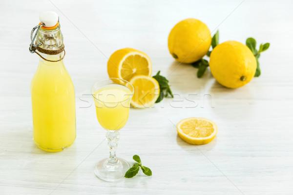 Italian traditional liqueur limoncello with lemon Stock photo © master1305