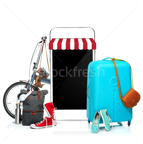 The blue suitcase, sneakers, clothing, hat, and phone on white background. Stock photo © master1305