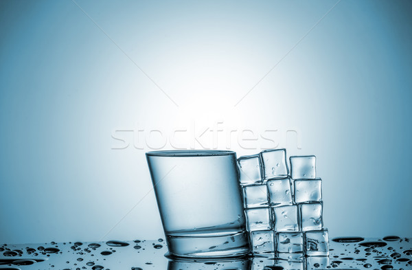 Water in glass and ice cubes, lying next Stock photo © master1305