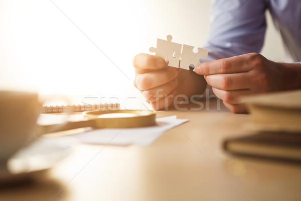 Building a business success. The hands with puzzles Stock photo © master1305