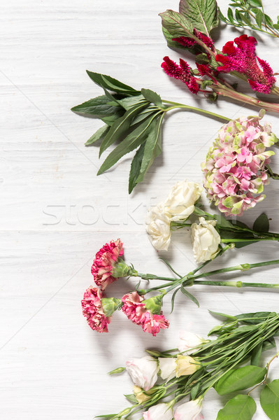 The flowers on white wooden background Stock photo © master1305