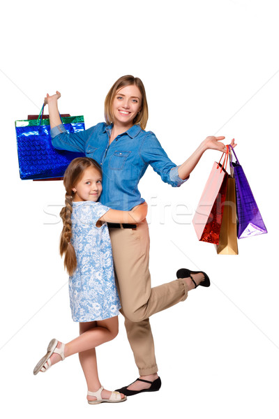 Happy a mother and daughter with shopping bags standing at studio  Stock photo © master1305