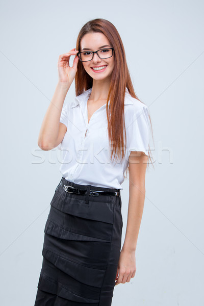 The smiling young business woman on gray background Stock photo © master1305