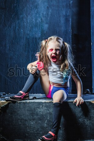 The funny crasy girl with candy on dark background Stock photo © master1305