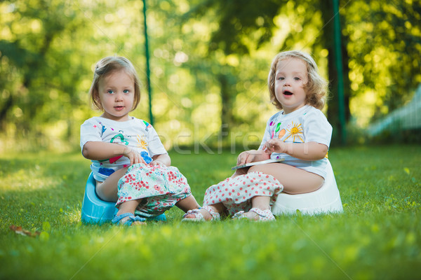 The two little baby girls hanging upside down Stock photo © master1305