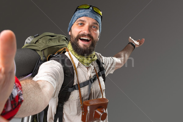 Stockfoto: Portret · glimlachend · mannelijke · toeristische · rugzak · camera