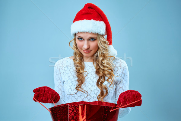 Frustrated and annoyed beautiful young woman in Santa Claus hat Stock photo © master1305