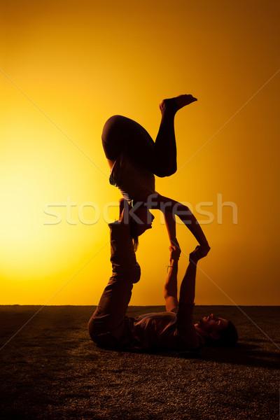 Két személy gyakorol jóga naplemente fény kettő Stock fotó © master1305