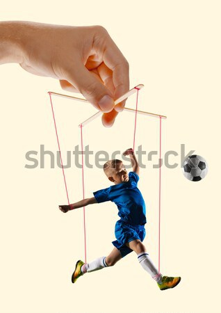 The portrait of man with ball, holding selfie stick on white background Stock photo © master1305