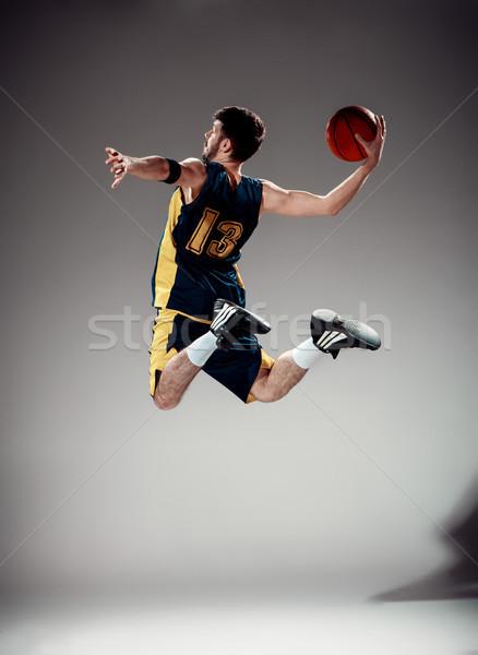 Teljes alakos portré kosárlabdázó labda szürke stúdió Stock fotó © master1305