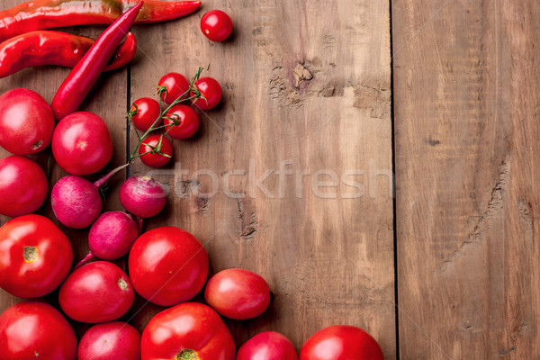 The red vegetables on wooden table Stock photo © master1305