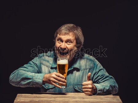 The screaming man in denim shirt with glass of beer Stock photo © master1305