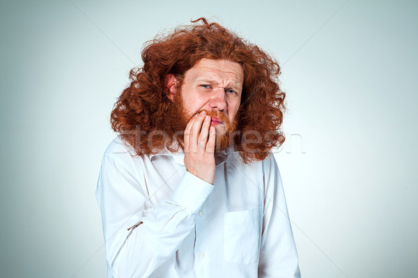 Young man is having toothache. Stock photo © master1305